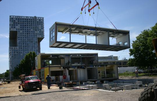 Pre-fabricated buiding units being placed at Cambridge site